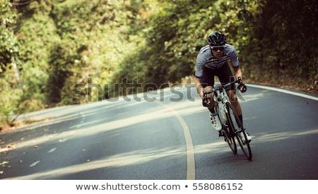 woman riding a bike on a mountain road stock photo © vlad_star