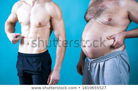 Happy athletic man with muscular torso  Stock photo © deandrobot