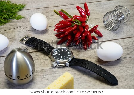 Red hot pepper with alarm clock Stock photo © cherezoff