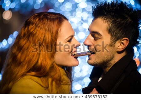 Two young woman enjoying a winter night out Stock photo © dash