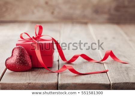 Valentin nap ajándékok hölgy kéz rózsa szépség Stock fotó © Vg
