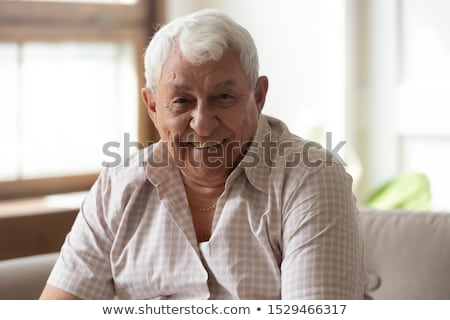 handsome mature man posing seated stock photo © feedough