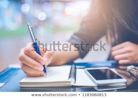 Mujer manos escrito cuaderno oficina Foto stock © happydancing