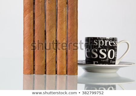 Different cigars and cups of coffee on a  glass table  Stock photo © CaptureLight