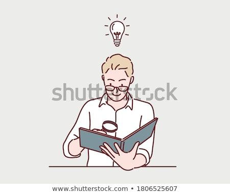 Stock photo: Image of a man  reading a book with magnifying glass