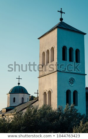 Small white church and bell tower in Ulcinj town, Montenegro Stock photo © Steffus