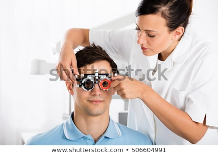 Female Optometrist Checking Patient's Vision With Trial Frame Stock photo © AndreyPopov