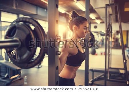 Woman squat barbell. Stock photo © Kurhan