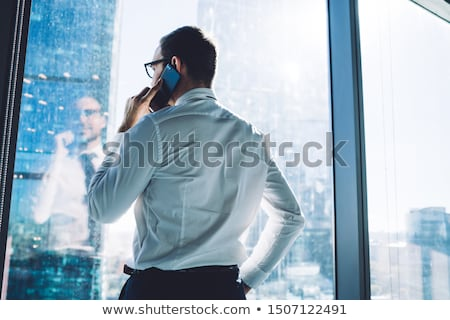 Stock photo: Back view of business man with phone