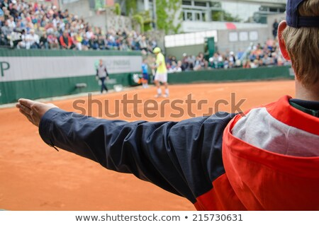 tennis line referee and tennis player after serve stock photo © smuki