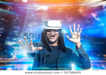 若い男 · 演奏 · ビデオゲーム · バーチャル · 現実 · 眼鏡 - ストックフォト © simpson33