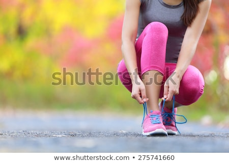 running shoes   woman tying shoe laces woman getting ready for stock photo © vlad_star