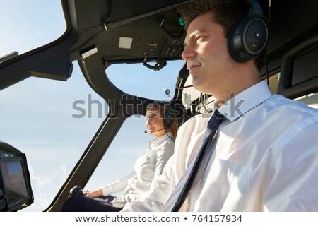 Piloto mulher helicóptero em pé ao ar livre Foto stock © artfotodima