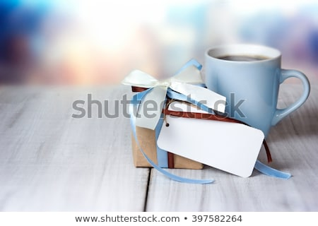 Blue fathers day greeting card on wooden table Stock photo © wavebreak_media