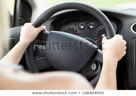 Woman holding on black steering wheel Stock photo © stevanovicigor