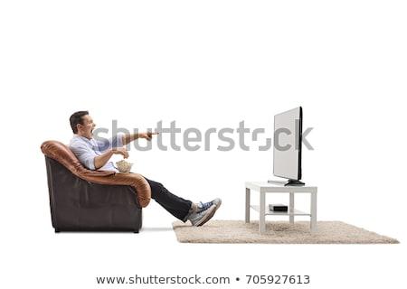 Férfi tv nézés technológia jókedv szék szín Stock fotó © IS2