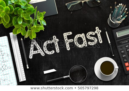 Stock photo: Act Fast Handwritten on Black Chalkboard. 3D Rendering.
