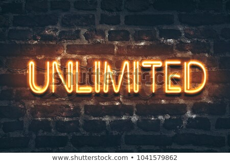unlimited neon sign on brick wall stock photo © stevanovicigor