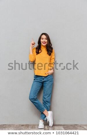 微笑 女子 毛線衣 冒充 臂 商業照片 © deandrobot