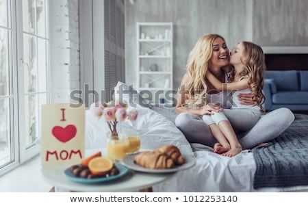 Mother and daughter breakfast together Stock photo © IS2