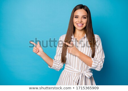 Girl showing direction Stock photo © IS2