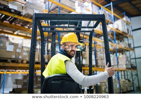 Warehouse worker in forklift stock photo monkey business images stock photo warehouse worker in forklift sciox Choice Image
