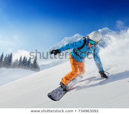 Man snowboarden beneden helling sport snelheid Stockfoto © IS2