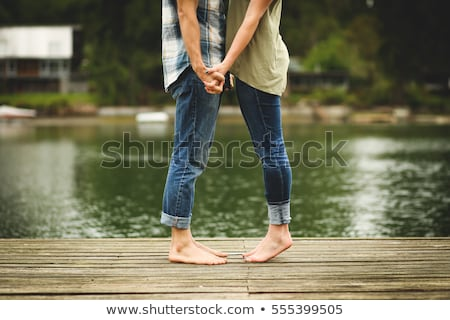 couple on a dock smiling and relaxing stock photo © is2