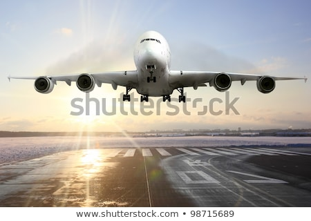 airplane wing aircraft turbine landing in snow winter stock photo © lunamarina