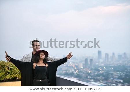 Casal varanda feliz cityscape preto menina Foto stock © bezikus