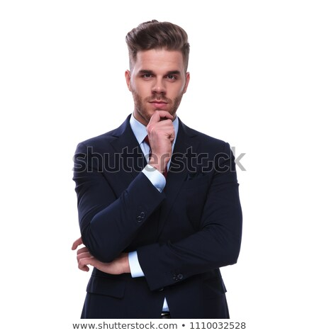 portrait of pensive young businessman in navy coloured suit Stock photo © feedough