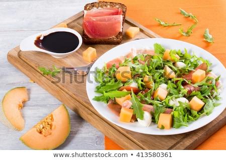 melón · ensalada · prosciutto · jamón · mozzarella · madera - foto stock © M-studio