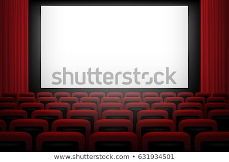 movie theatre with rows of red seats and blank white screen vector stock photo © andrei_