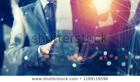 Businessmen that works with his laptop. Concept startup company. double exposure Stock photo © alphaspirit