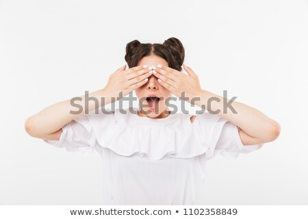 Photo of excited teenage girl 20s with double buns hairstyle and Stock photo © deandrobot