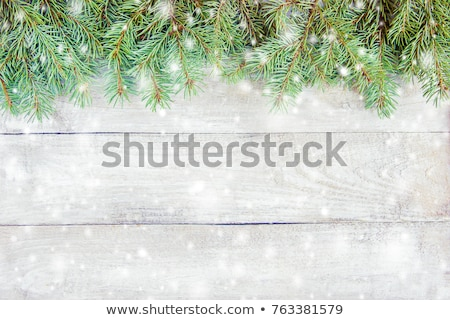 Christmas lights, gift boxes and mittens Stock photo © karandaev