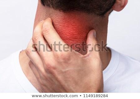 Doctor Checking Man's Sore Throat Stock photo © AndreyPopov