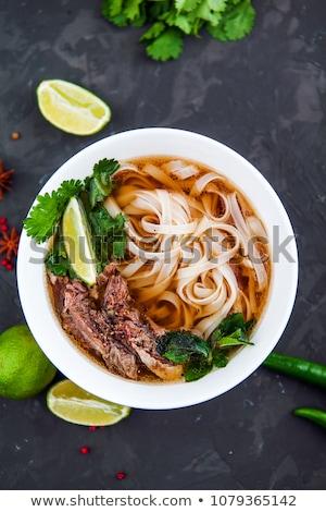 Pho Bo - Vietnamese fresh rice noodle soup with beef, herbs and chili. Vietnam's national dish Stock photo © galitskaya