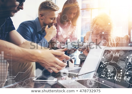 Business woman working on laptop with global financial report concept Stock photo © ra2studio