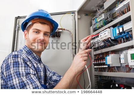 electrician examining a fuse box stock photo © andreypopov