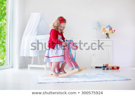 Little girl playing on rocking horse Stock photo © colematt