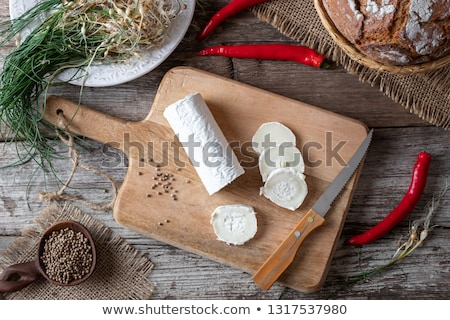 pickling goat cheese with crow garlic and hot peppers top view stock photo © madeleine_steinbach
