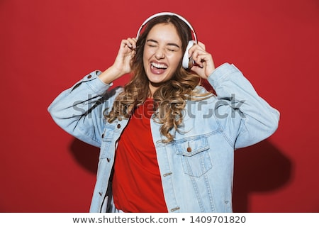 Smiling red haired teenage girl in earphones Stock photo © deandrobot