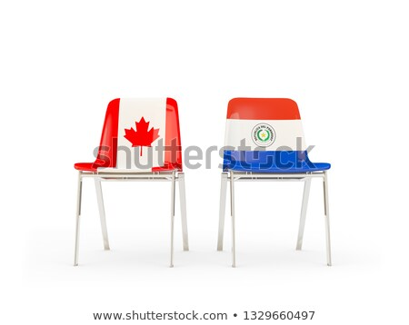 Two chairs with flags of Canada and paraguay Stock photo © MikhailMishchenko