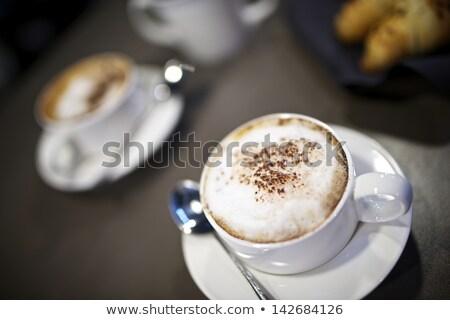 Közelkép kerámia tányér kanál asztal eszik Stock fotó © dolgachov