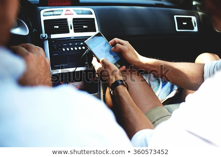 young man using a smpartphone as a GPS in a car Stock photo © nito