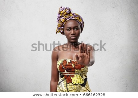 Attractive young African woman giving halt gesture Stock photo © Giulio_Fornasar