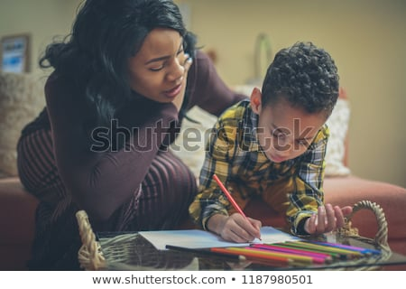mother help Black boy doing homework at home Zdjęcia stock © Lopolo