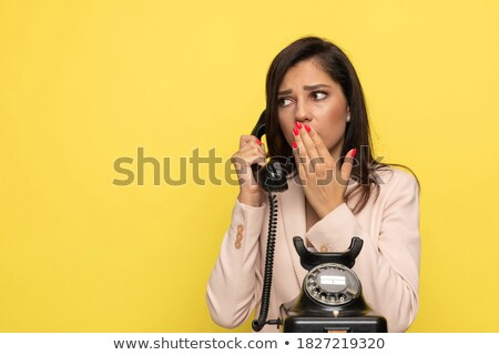 Shocked Businesswoman Talking On Telephone Stock photo © AndreyPopov