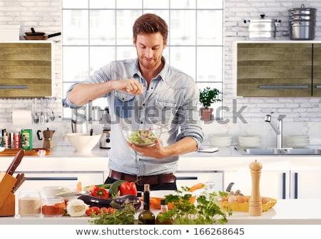 Jóképű fiatalember ételt készít otthon rusztikus konyha Stock fotó © boggy